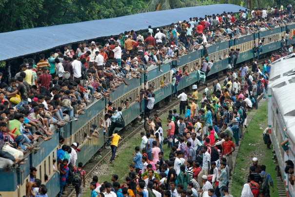 overloaded train with passengers going to their hometowns on festival holidays