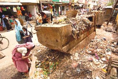 Open Roadside Waste Rotting Under the Open Sky in Dhaka.